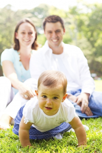 Couple with baby crawling