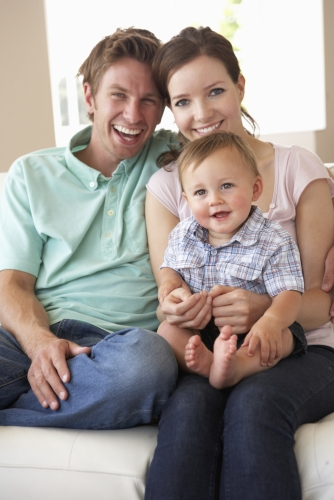 Couple enjoying playing with son